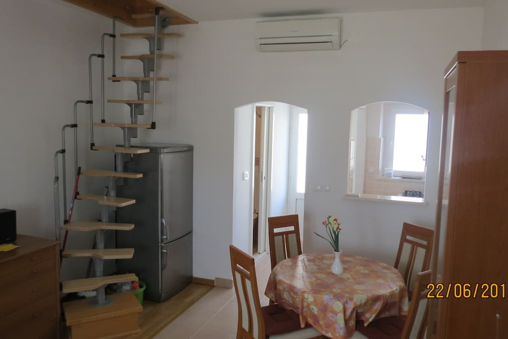 Living room + stairs to the loft space