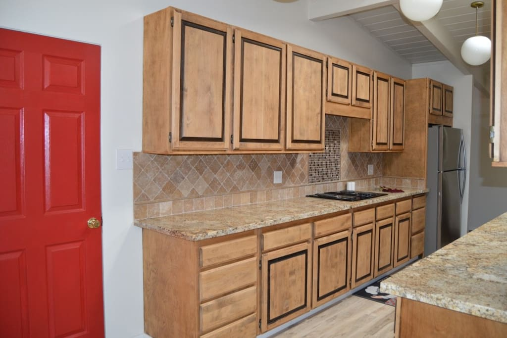 Kitchen remodeled with grant countertops, new cabinets and flooring