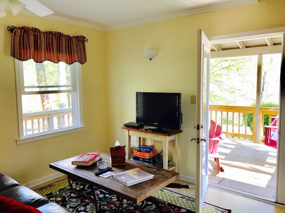 The living space in Jack's has a large, comfortable couch, a rocking sofa, coffee table and TV/DVD player.  The porch is on two sides of the house and is perfect for listening to the Tye River!