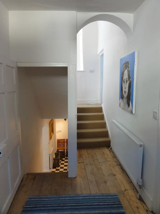 Entrance hall with stairs to lower ground floor kitchen and stairs to first and second floors
