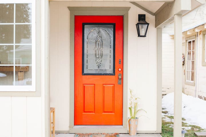 The cottage has lots of character like this distinctive red door.