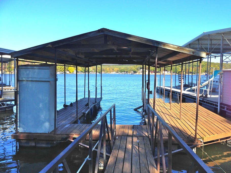 Single boat dock will fit a 30 foot boat. Swim dock with ladder.