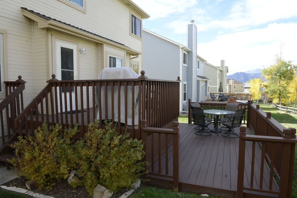 Outdoor furniture and large grill available for use