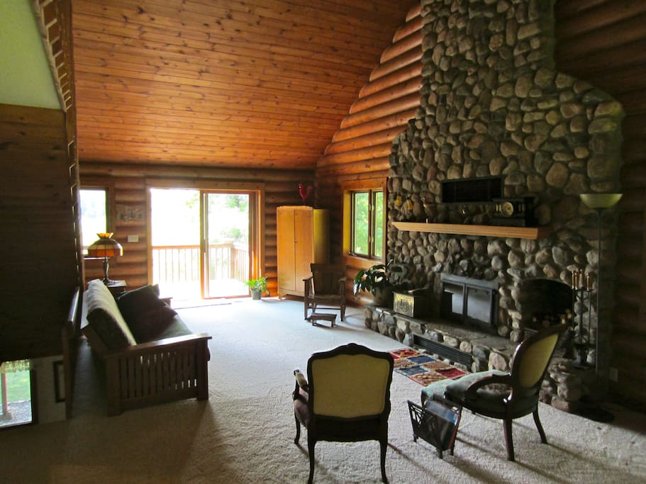 """The Great Room opens up towards the lake and has a fireplace for those cool days.  """"We loved having the beautiful fireplace available for fires when it got chilly at night."""" - Sandra 2017"""