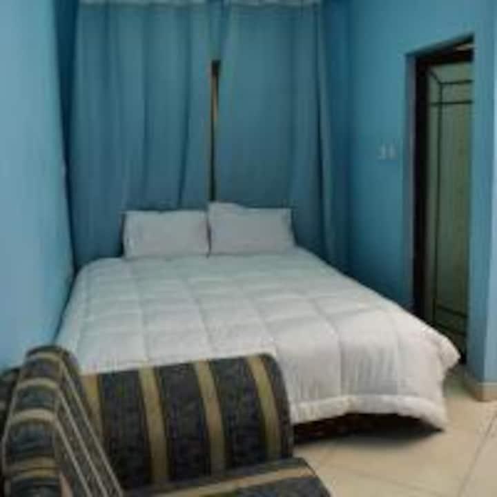 Chrisma Courts (Blue Room)