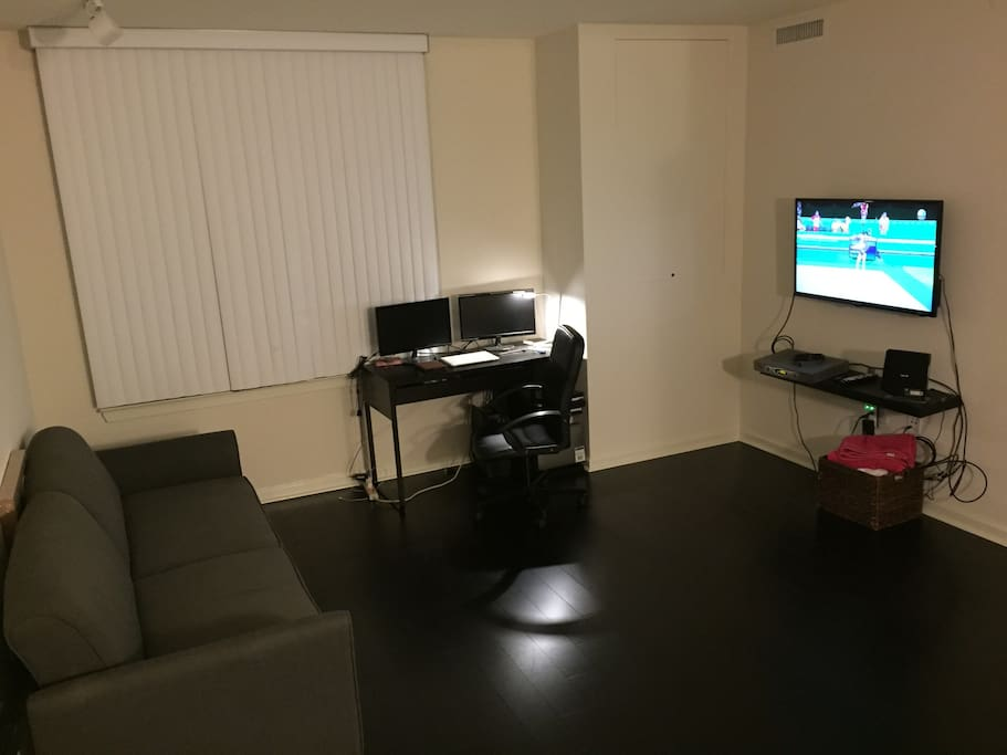 Living room w/couch, TV , and workdesk