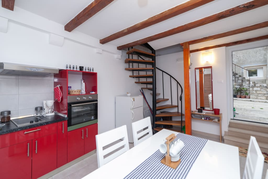 Modernly equipped kitchen and dining area