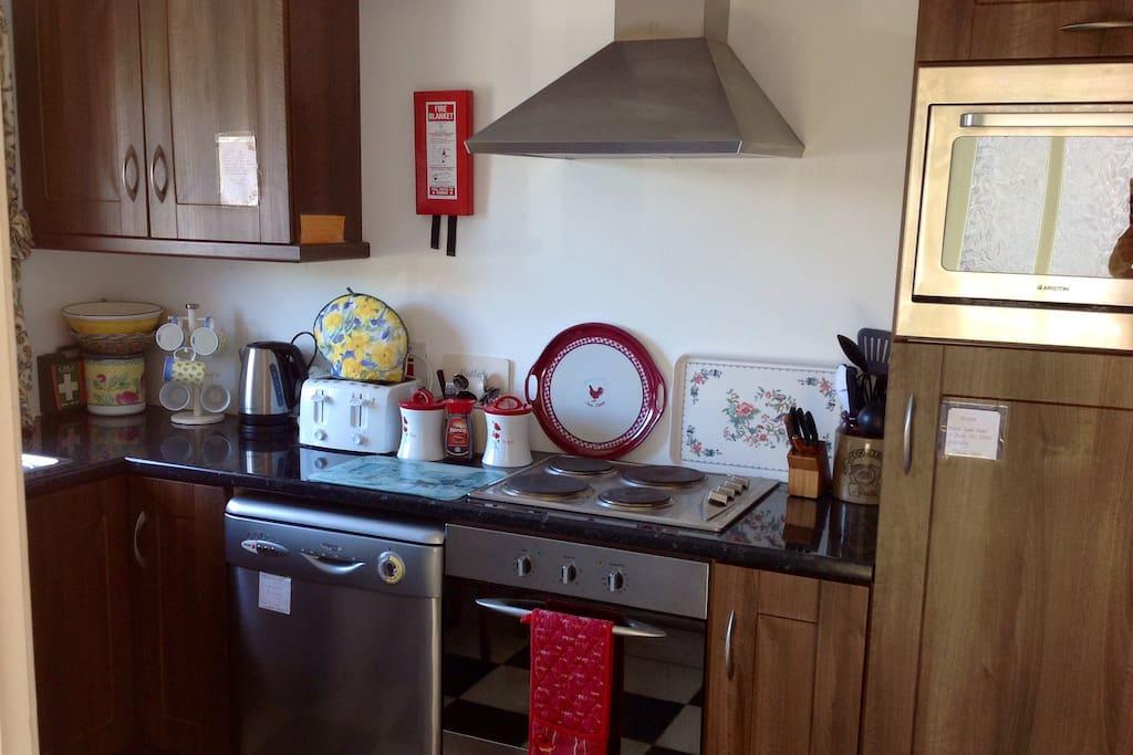 Full equipped kitchen , dishwasher, microwave , washing machine,oven, crockery etc.