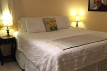 King size bed fitted with 100% cotton linens, TV with satellite & HBO, Wi-Fi, Ceiling fan, Air Conditioner