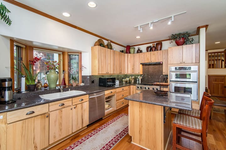 The roomy kitchen is fully equipped with all the appliances and cooking essentials you need.