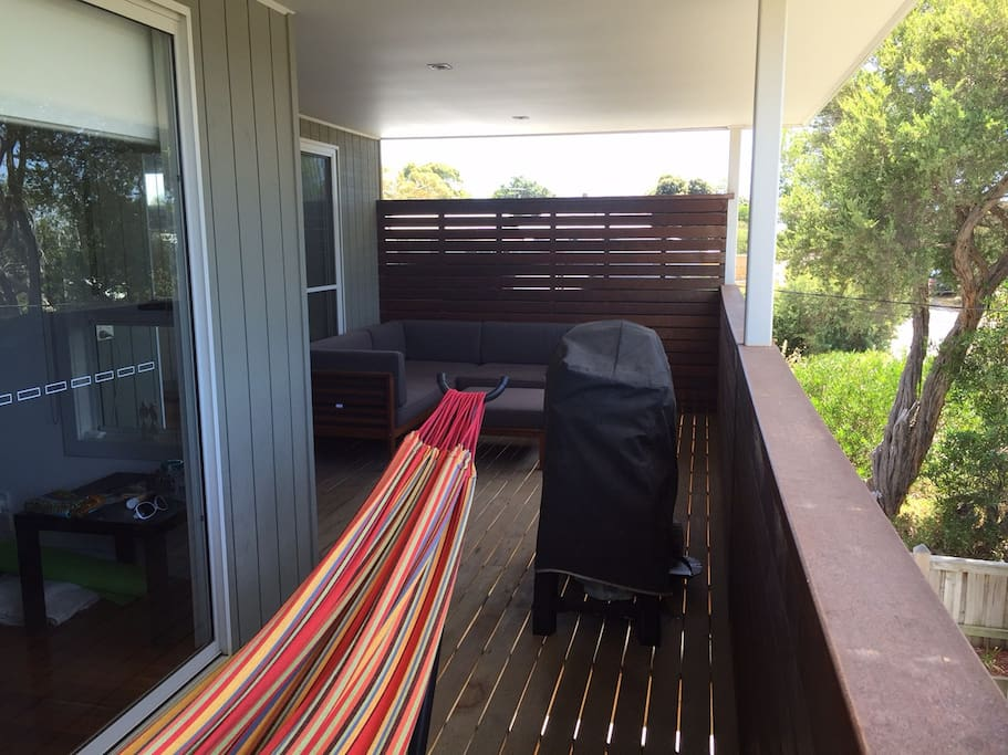 Front Deck overlooking Arthurs Seat with Weber Q, lounge area and hammock