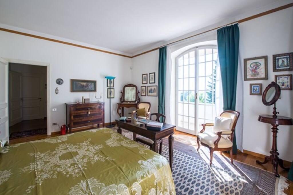 Bedroom has a balcony with a beautiful vista!