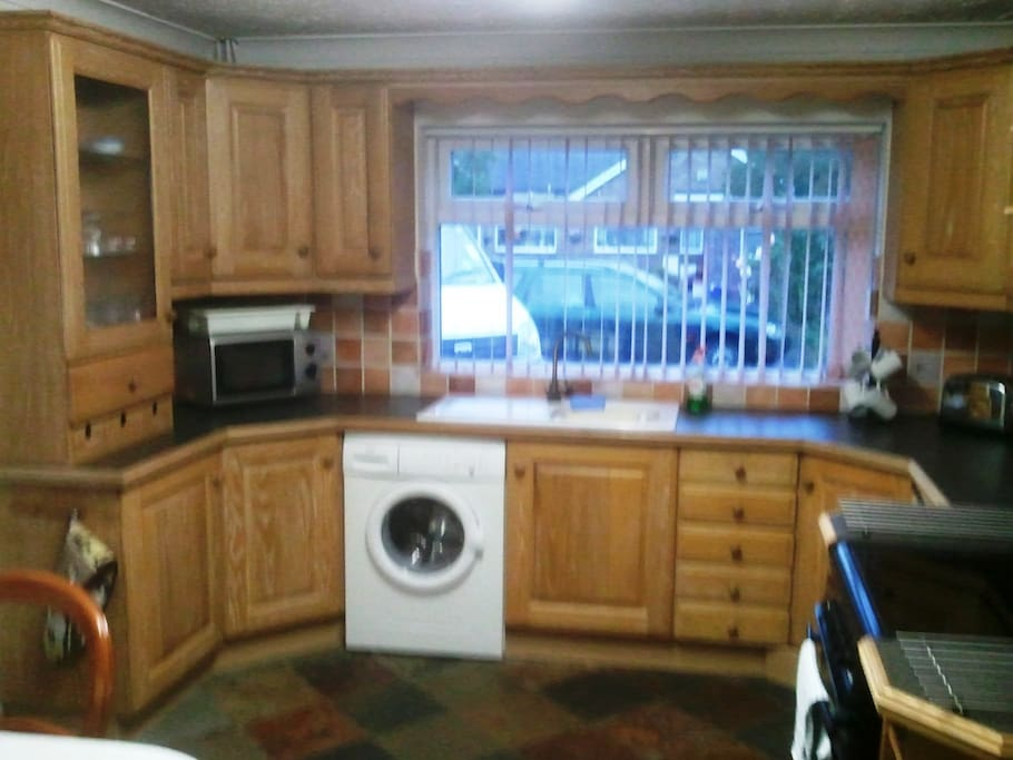 Spacious kitchen with plenty of storage space.