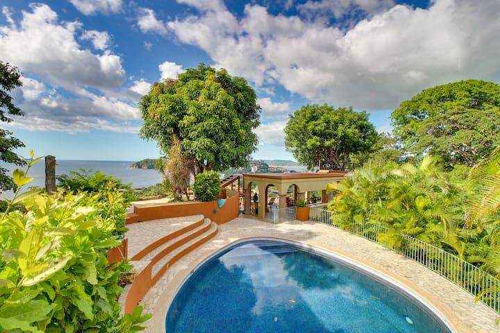 Hilltop villa & 3 guesthouses w/ pool, decks & amazing ocean view - near beach!