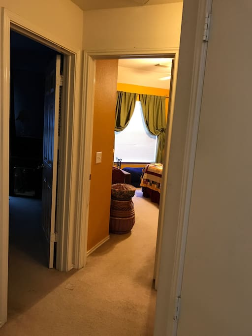 Upstairs bedroom at far end of the hallway. Bathroom right outside of the room.