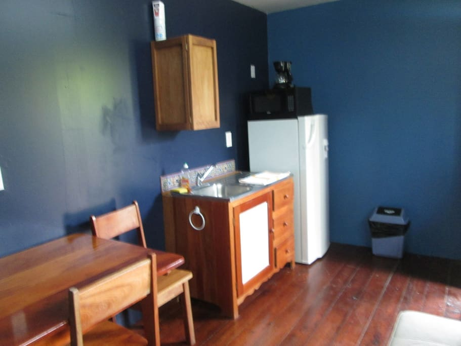 Kitchen includes, largew fridge, water dispenser, coffee maker