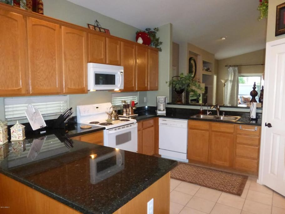 Roomy eat in kitchen is well equipped for families and entertaining.