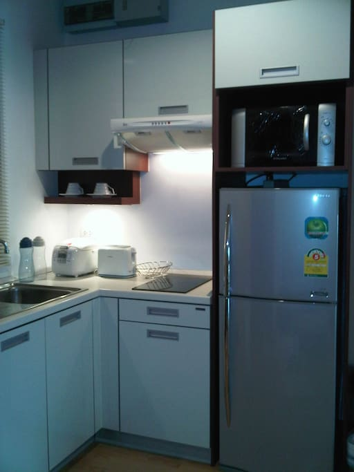 Kitchen with cooker, toaster, stove, microwave and refrigerator