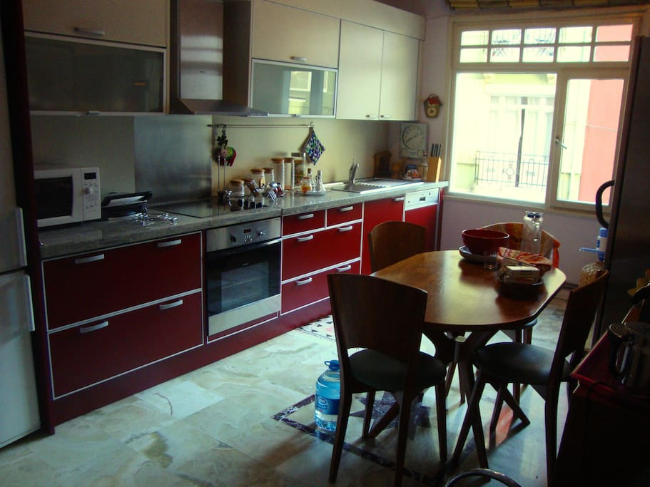The Kitchen is big and bright with all appliances, facing the main street.