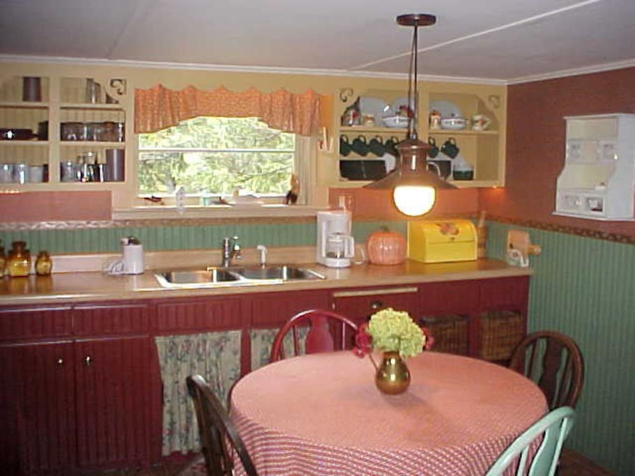 Rustic chic upstairs kitchen and dining room.