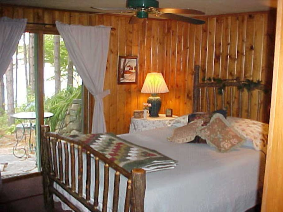 Lower level bedroom with walk out lake side patio.