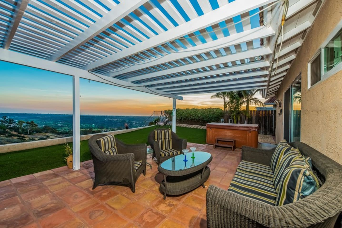 Amazing sunset views from the back patio, relax in the private hot tub too!