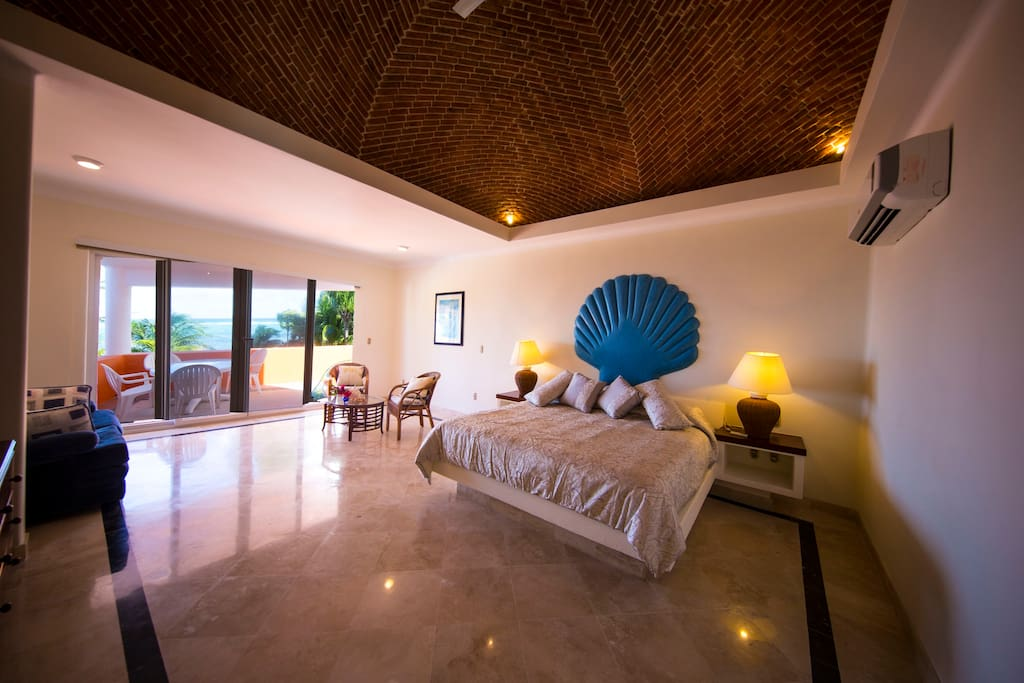 Spacious  Master bedroom with balcony and breathtaking Caribbean Sea view