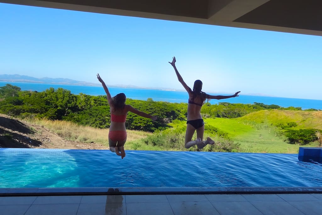Jumping into the infinity pool from the villa deck