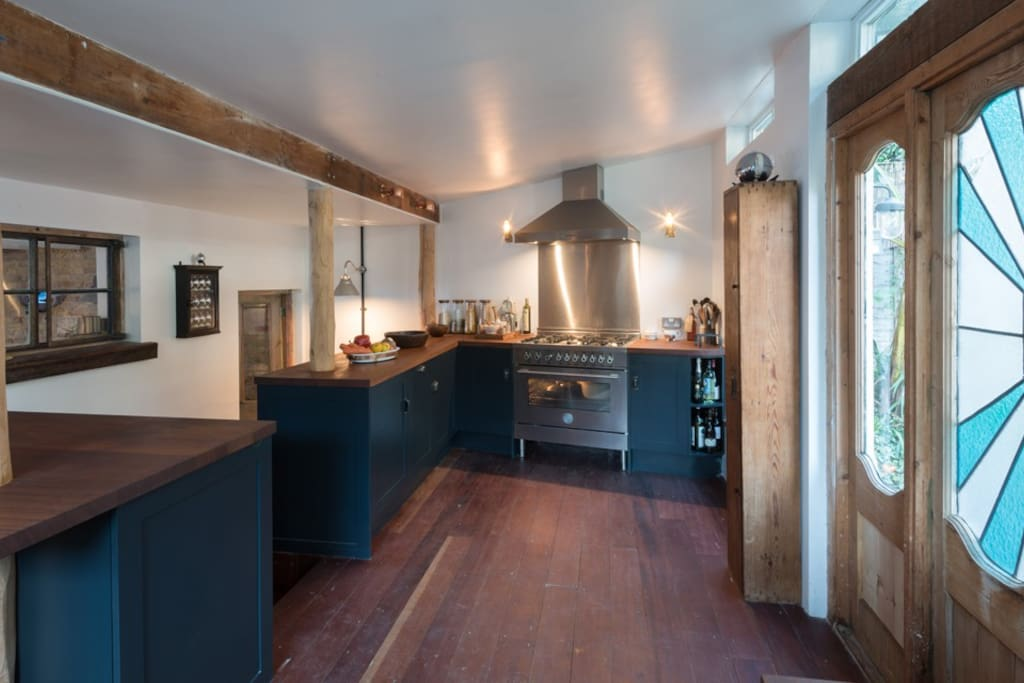 Kitchen with 3 work stations & range stove.