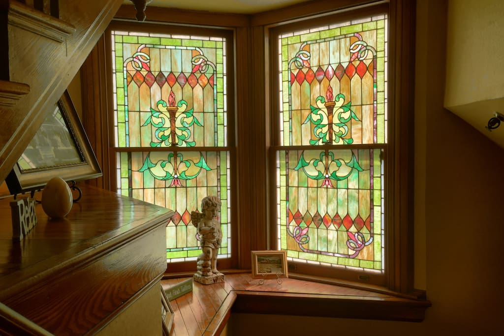 There are two sets of beautiful stained glass located on two different floors!