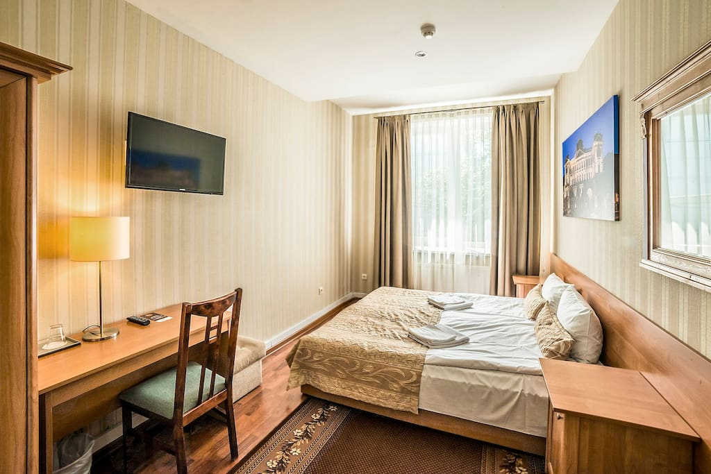A 19m² private single room with either one large bed or a single bed. It comes with private WC and shower, free Wi-Fi, shampoo, hairdryer, work desk, wardrobe & more.