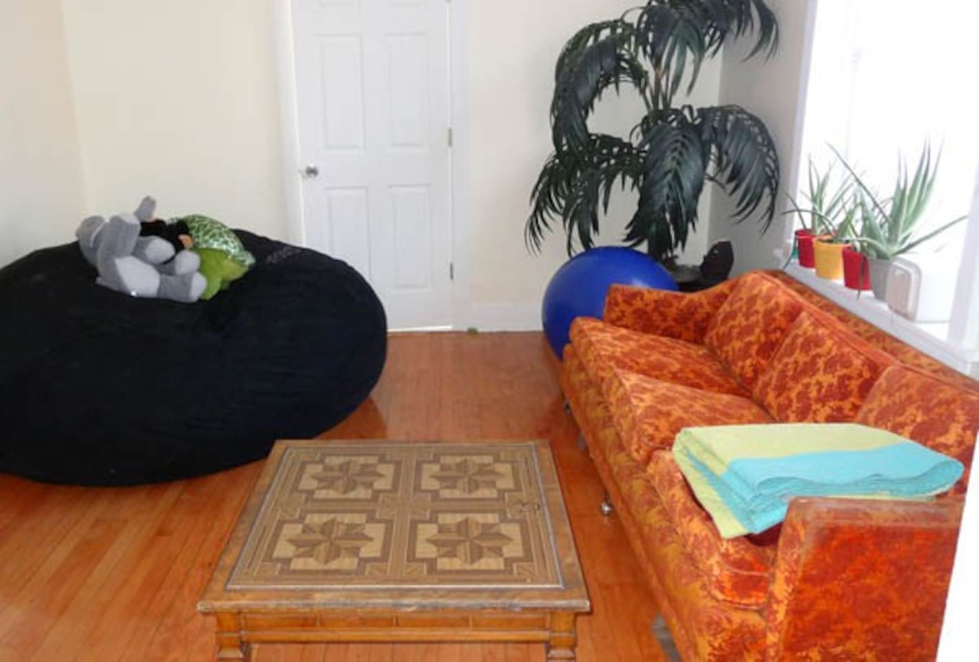 Living room with vintage couch and giant Lovesac bean bag :)