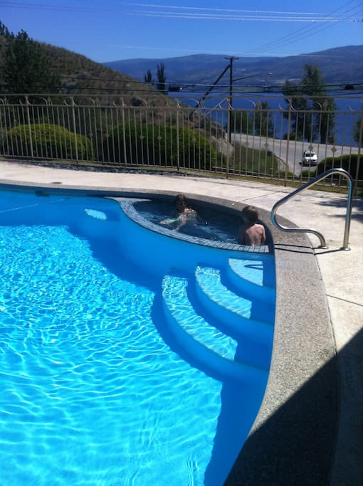 Private in ground heated pool with view of lake