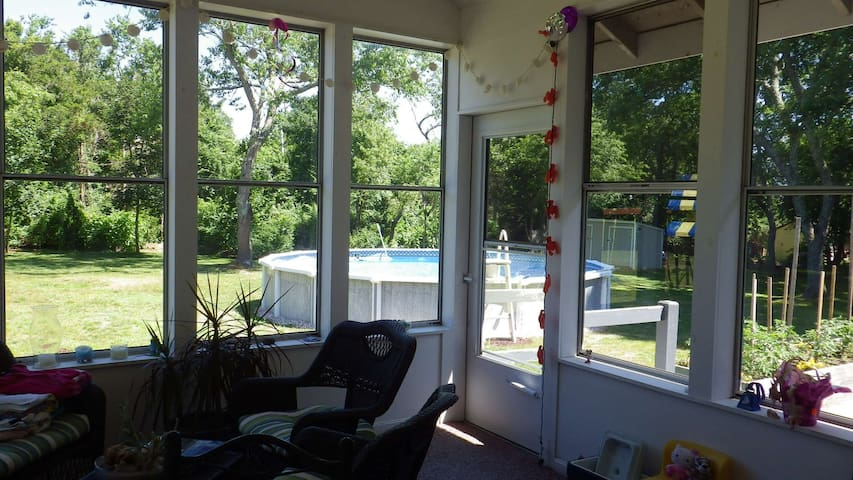 Huge, private backyard with Pool photographed from heated 3 season room.