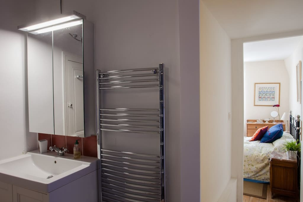 Large en suite shower and basin with heated towel radiator