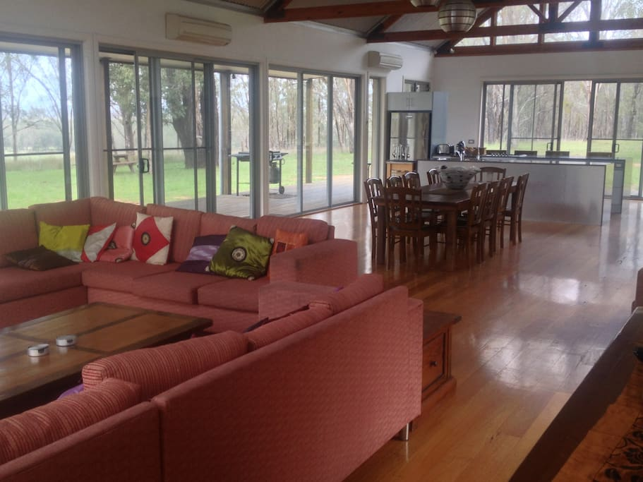 Huge lounge, dining, kitchen area, windows all around, views over open country and Hunter Valley