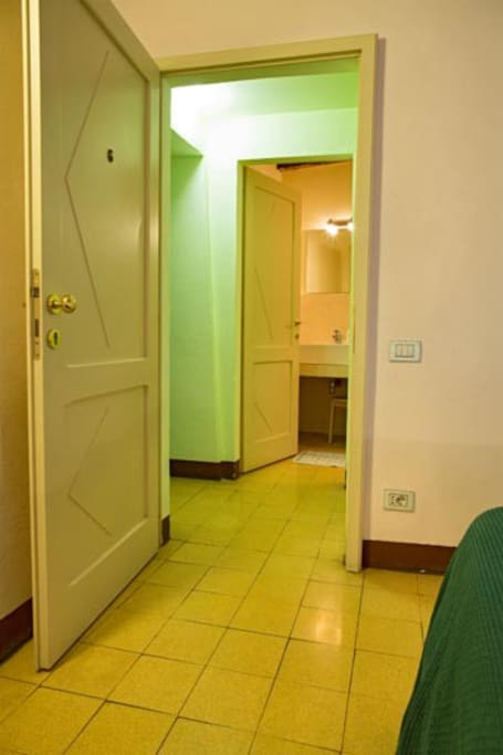 Room No. 6, the private bathroom is just in front of the bedroom, in an enclosed area private to this room