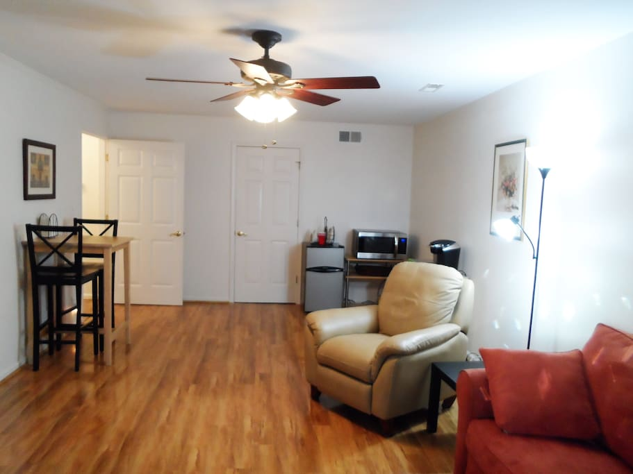 Spacious living area with Flat screen TV, CD and video player.