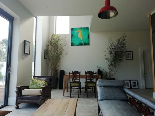 Open- plan dining and one of living areas