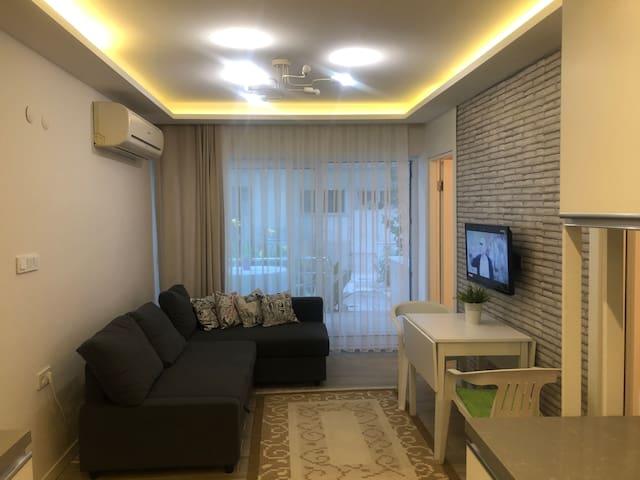 A new decorated flat 2 min. walk away to beach