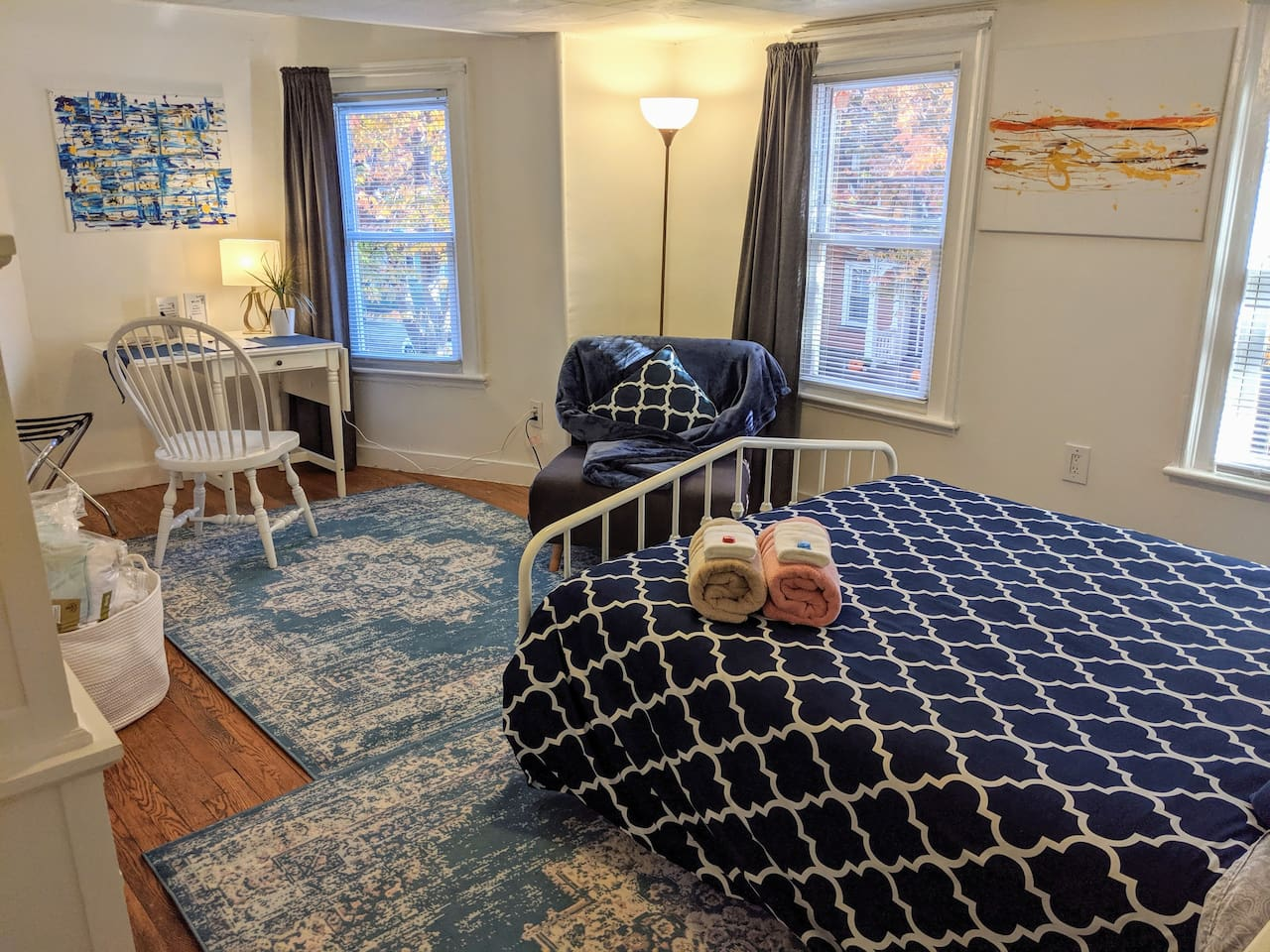 Spacious room with queen-sized bed, convertible lounge chair that could be opened to stretch out your legs or flat to be an additional single sleeping area, drop leaf desk, dresser, closet w/ hangers, bedside tables with reading lights on both sides.