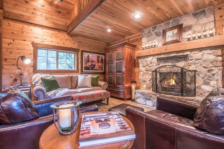 Charming living room with wood burning fireplace, seating for 5.