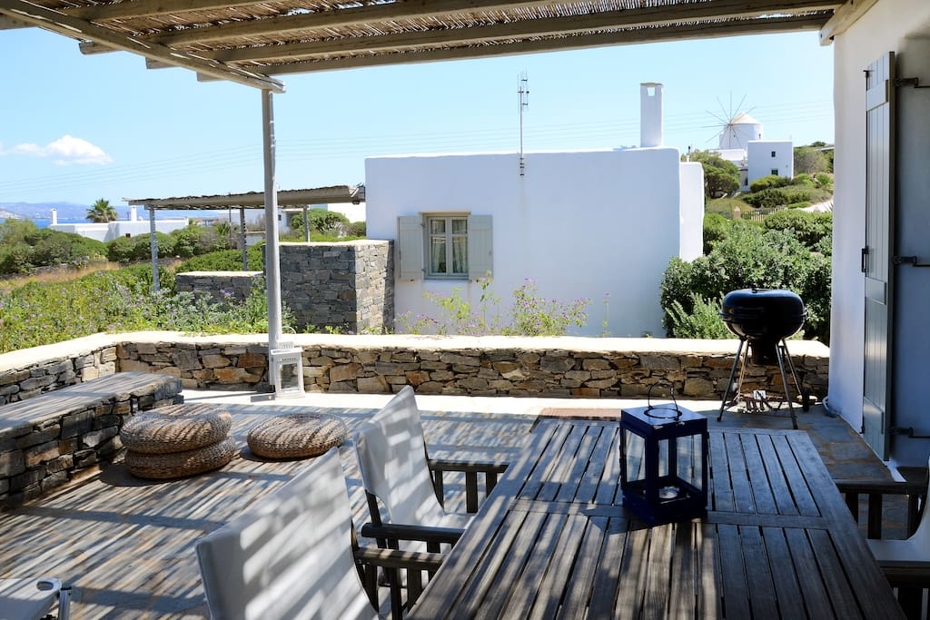 Terrace with  outdoor sitting and BBQ. You can enjoy wonderful sea views while eating, drinking or relaxing al fresco