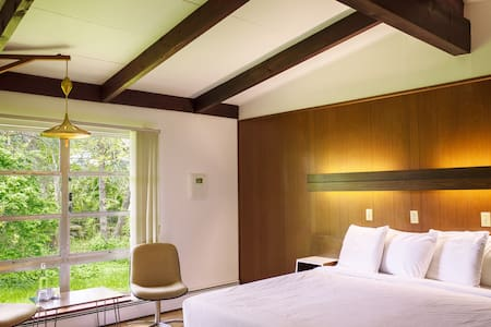 Period restored mid-century rooms offer a clean and minimal aesthetic. New memory foam mattresses and domestically produced (USA made) linens and towels.
