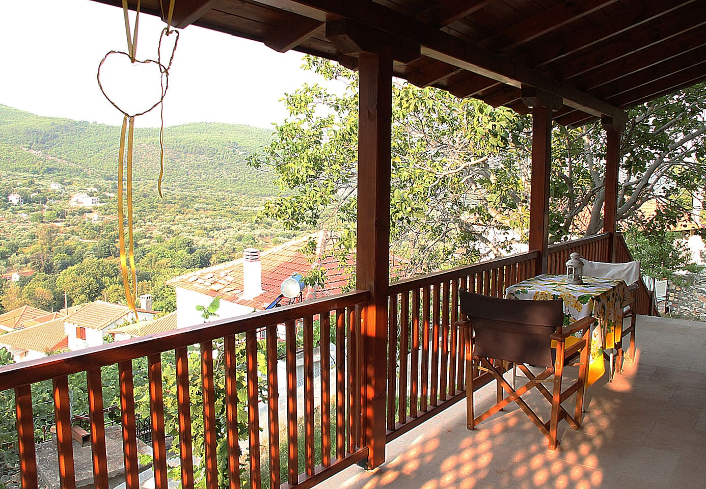 The Veranda with the view of Agios Georgios a traditional village