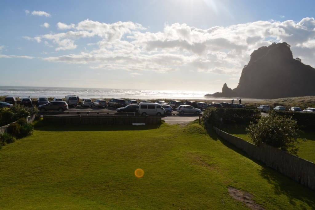 Enormous front lawn with views of beach & Lion rock