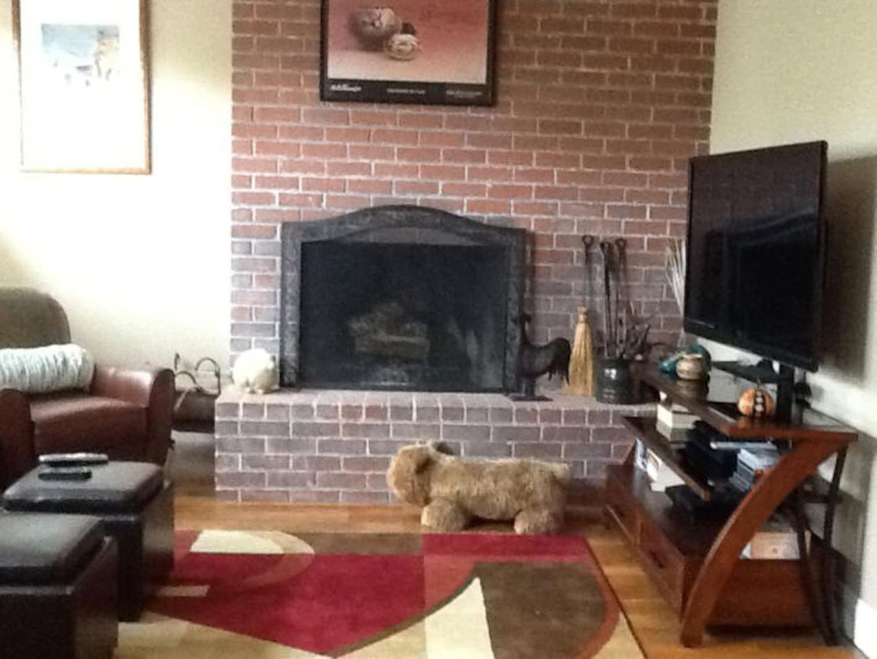 Living room has wood burning fireplace.