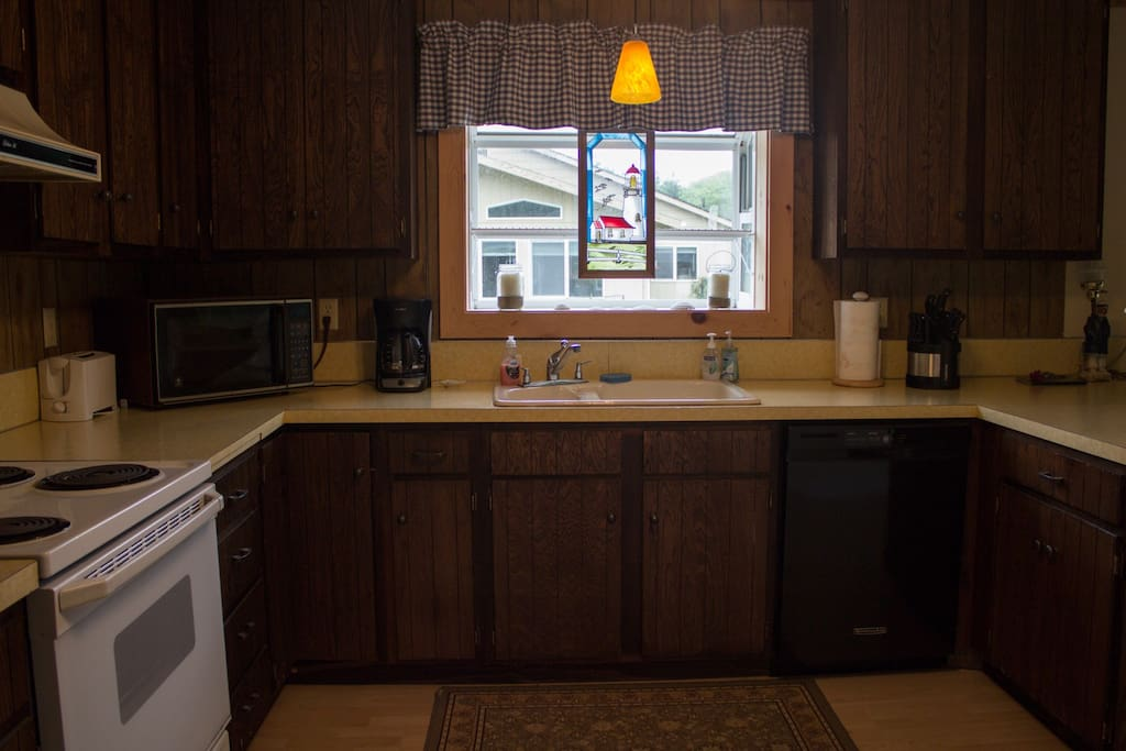 Spacious kitchen with full amenities.