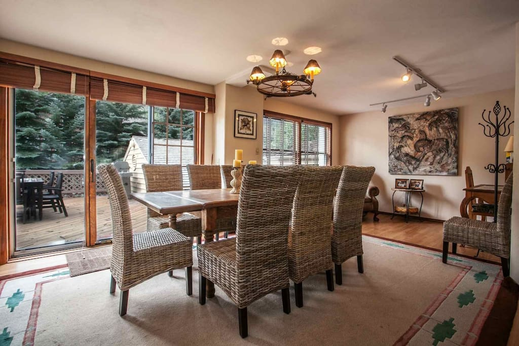 Dining room with seating for 8 and access to deck with gas grill and outdoor dining table.