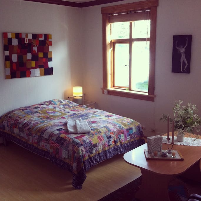 Bright and beautiful bedroom with 2 large windows